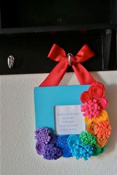 rainbow colored flowers on a wreath would be pretty for spring