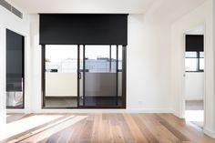 Blockout roller blind in classic black colour. | Window Furnishing: Roller Blinds | Room: Kitchen & Living