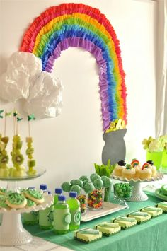 Saint Patrick's Day party. Complete with rainbow & pot of gold wall decor & green shamrock everything. Four-leaf clover shindig!!