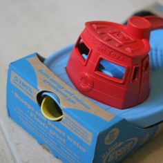 The red Green Toys tug boat bath toy is a great toddler toy and is 100% made from recycled plastic milk cartons. It comes in stylish recycled and recyclable packaging too.