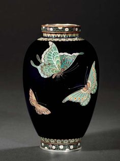 A CLOISONNÉ VASE SIGNED ON A SILVER TABLET KINUNKEN ZO, MEIJI PERIOD (LATE 19TH CENTURY) Worked in various thicknesses of silver wire and coloured cloisonné enamels on a dark blue ground with butterflies, copper and silver mounts