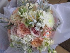Coral, blush pink and lemon always looks so fabulous for a #summer #wedding #bouquet. My bride originally asked for dusky pinks...but was so pleased that she had changed her mind when she saw her stunning flowers!