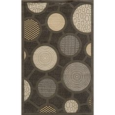 Rich, earthy tones come together in an eye-catching abstract pattern on this Power-Loomed Soho rug. Made of New Zealand wool, this rug features a hand-made finish consisting of hand-serged edges and hand-carving.