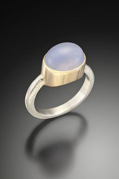 Textured sterling silver and 14K yellow gold ring with blue chalcedony cabochon by Estelle Vernon