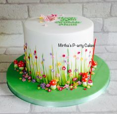 """Just a little spring flowery drum cake and hand painted grass. 7"""" by 6.5"""" tall."""