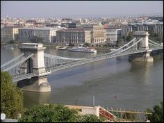 The Széchenyi Chain Bridge in Budapest spans the Danube river, connecting the Western and Eastern parts of the city. Description from teacollection.com. I searched for this on bing.com/images