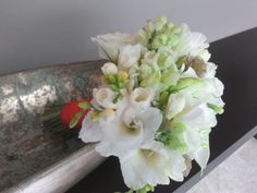 Bridal bouquet with lisianthus, calla lilies, Snapdragons, scabies and fressias.