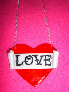 Love Tattoo Heart Necklace by RotandRoll on Etsy, £5.00