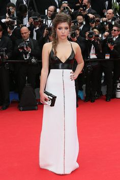 Adèle Exarchopoulos in a Louis Vuitton dress and bag, and Chopard earrings