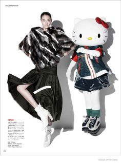 Hello Kitty Style--Model Ai Tominaga gets a famous co-star for her latest work featured in the December issue of Vogue Japan. A life-sized Hello Kitty pose
