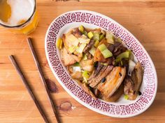 """Sichuan Twice-Cooked Pork Belly   A classic Chinese dish made with boiled-then-stir-fried pork and plenty of leeks and fermented black soy beans. Boiling the pork (the first """"cooked"""") renders some of the fat and makes it easier to slice and crisp up later in a blazing-hot wok."""