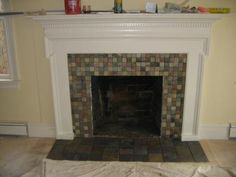 stone tile fireplace surround with contemporary mantel