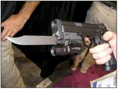 Tactical pistol bayonet. With flashlight