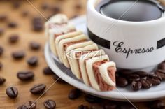 Close-up shot of coffee beans and cookie with black coffee. Download the photo without watermark @ www.kozzi.com or you can click the image.