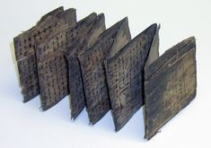 Palmleaf Manuscript: Woven palm leaves folded into a concertina structure.