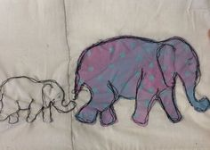 Baby elephant will be inverted colours of the big one and they will be stitched onto pale blue background. Can also add something too add abit of excitement if necessary.  (Actual one won't have funny line down the middle)