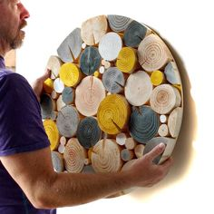A unique and contemporary wood feature for your home in shades of yellow, grey and white, this circular modern Log Slice Mosaic looks fantastic hung above a fireplace or bed.but why not create a talking point and hang three in a row on a plain wall? Hanging Wall Art, Diy Wall Art, Wood Wall Art, Wood Walls, Mosaic Artwork, Mosaic Wall Art, Wall Tiles, Diy Art Projects, Wood Projects