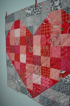 Heart mini quilt, with tutorial, by Hopeful Homemaker.  Cross-hatch quilting.
