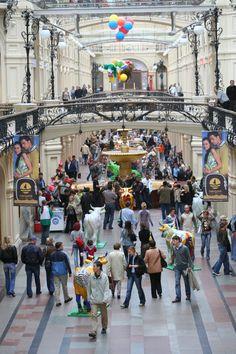 Shoppers inside GUM department store.