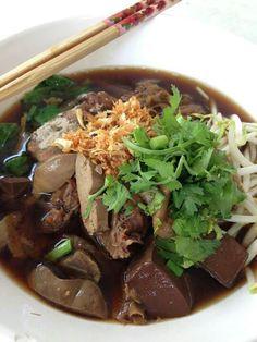 ก๋วยเตี๋ยวน้ำ (wide rice noodle soup with vegetables and meat). Thai food.