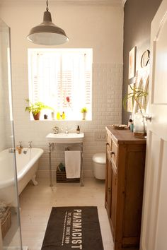 love the sink and the claw foot bathtub in this bathroom.