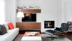 comfort-and-warm-livingroom-with-fireplace-midcentury-armchair-with-nice-interior-furniture.jpeg 1,024×597 pixels