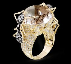 Ant Ring with Crystal  Ant ring set in 18k yellow gold with crystal and diamond.