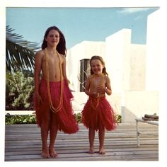 My sister in her new grass skirt. Me in her old one.