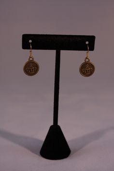 Bronze queen earrings.Mountain Laurel Boutique