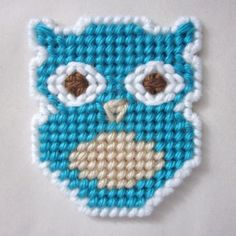 Surprised owl magnet in plastic canvas (teal) by AuntCC on Zibbet