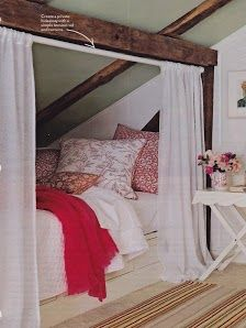 bed under the eaves with curtain for privacy