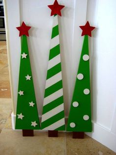 This set of 3 darling christmas trees can be indoors or on your porch. Super bright happy colors make these trees a must have with polka dots, stars, & stripes topped off with chunky Red stars. ~~~~All tree together sized side by side aprox:20 single aprox 35 x 6 1/2 and smaller two aprox 31 x 6 1/2 ~~~~~Priced as a set only $130.00 If you want just a Single Convo and we can do a CUSTOM ````````SALE SALE Priced at only $99.00 ......Shipping only on Mainland USA.....Thanks ❤️