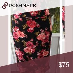 LulaRoe Cassie floral L black Cassie pencil skirt black background with red and pink flowers. Has A Lot of stretch and I was told it did not so I went up a size. I'm a size 6/8 for ref and this is for 8/10 it was just too lose and again has as much stretch as the regular cassie. Worn once washed and hung dry as instructed. LuLaRoe Skirts Pencil