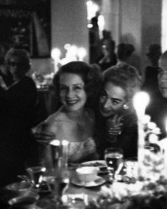 Norma Shearer and Joan Crawford at a Hollywood party, 1959 (photo by Eve Arnold)