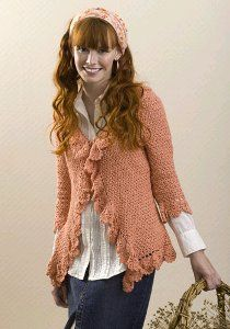 You'll absolutely love the look of this cardigan. It has a cute ruffle pattern throughout the cardigan. The coral lipstick color is great for the spring and summer months.