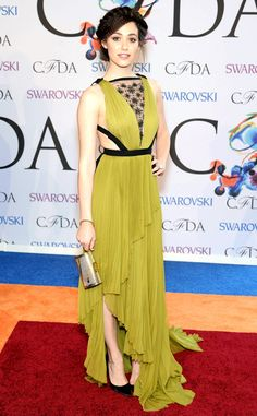 Emmy Rossum strikes a pose in this chartreuse and black gown with cutout detailing at the sides.