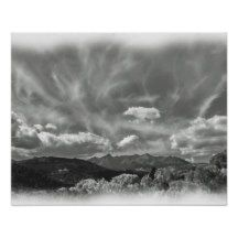 This artwork is highlighted by the unique clouds over the mountains.