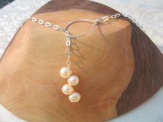 Such a classic style with a new twist!  Pearls have always symbolized elegance, and now they are chic too!  With the opening in the front to create a Y, this necklace will really make a statement.  The hoop measures about 3/4inch and the pearls measure about 1inch.  The necklace is 18 1/2inches long. $42.00