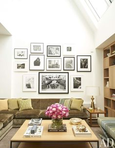 Nicely done display of photos/ artwork. Spectacular Living Room Inspiration from Design Pros Photos | Architectural Digest