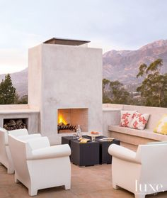 Modern Outdoor Terrace with White Concrete Fireplace