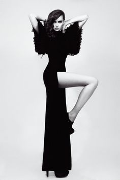 Model Pose with striking silhouette - allure & elegance; stylish black & white fashion photography