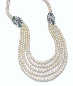 AN ART DECO NATURAL PEARL AND DIAMOND NECKLACE. Comprising five graduated rows of 57 and 53 natural pearls gathered by two circular-cut diamond and rectangular-shaped emerald scroll-work clasps to the similar back clasp, circa Art Deco Jewelry, High Jewelry, Pearl Jewelry, Antique Jewelry, Vintage Jewelry, Jewelry Design, Art Deco Necklace, Jewlery, Pearl And Diamond Necklace