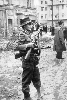 "Janos Mesz, also known as ""Janko of the wooden leg"", one of the leaders of the rebel group Corvin Lane, stands at the Erkel Theatre on Koztarsasag Square during the 1956 insurrection in Budapest. Photo by Erich Lessing. Hungary Travel, Unsung Hero, Military Pictures, Army & Navy, Magnum Photos, My Heritage, France, Vietnam War, Eastern Europe"