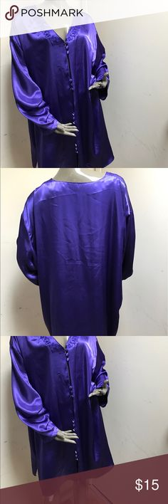 Satin purple tunic or robe? Front buttons design I never wore this. I did find a snag but it didn't mess up and pull I forget where It's in the back and near the arm price reflects.. damage. The front has a nice loop covered button detailing that creates an opening every few buttons. So beautiful and silky. I just had to see if anyone wanted color is a deep royal purple tag says 26/28 Tops Tunics