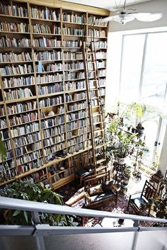 ::faints:: all those books! so high that one even has the need for a ladder to reach the top! and the natural light through those windows is just gorgeous... my goodness, it's like a greenhouse in heaven, where one can easily escape all day into a delicious novel! (or two...)