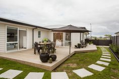 Our clients Rebecca Ward and Patrick Wilde love to entertain guests, so they extended the deck to have a big outdoor area to use.   #ourstories #client references #deck #houseplans #housedesign #newhome #outdoorarea #generationhomesnz
