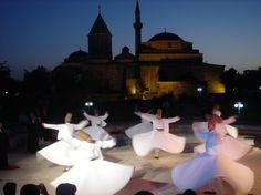 Whirling Dervish (Sema) ceremony in the courtyard of  Mevlana Jelaluddin Rumi's mausoleum in Konya Turkey.