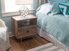 Fashioned from reclaimed pine wood shipping pallets, a rustic nightstand provides storage space for small odds and ends.