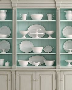 Beautiful robins egg blue painted cabinet back- would highlight my milk glass collection perfectly.