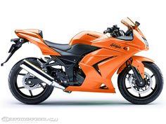 Orange Kawasaki Ninja 250r-- My dream bike! But only in neon green or bright blue!